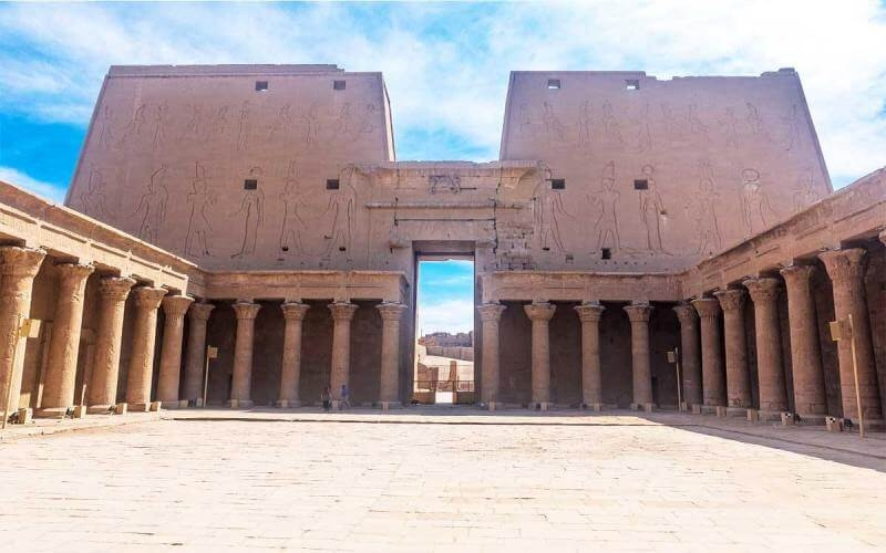 Entrance to Karnak Temple with soft clouds in the sky