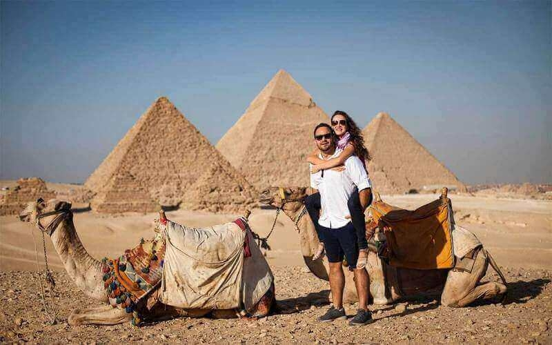 Experince the amazing camel ride adventure around Giza Pyramids, one of the top attractions in Egypt vacation