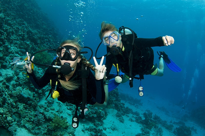 Young couples snorkeling underwater, red sea, Egypt