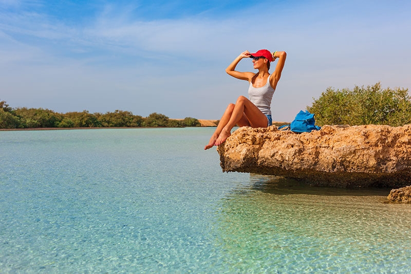 Solo Female Traveler enjoying the sun at the Red Sea