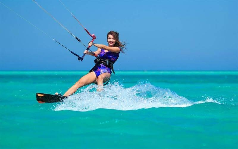 Solo Women Traveler enjoying water skiing at the red sea